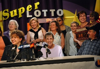 Gloria Madriz, left, speaks Tuesday in Sacramento for the group of 20 current and former state employees who won the SuperLotto Plus jackpot drawing on Saturday. The group has been playing the same numbers weekly for 10 years. Some of the winners said they are planning to go on vacations and pay off their mortgages.